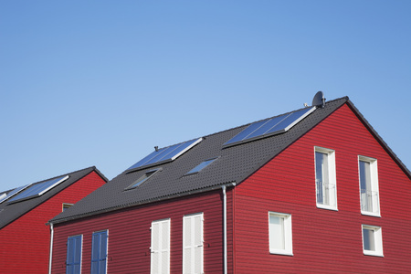Germany,Cologne,Roof Of Wooden Residential Building With Solar Panels