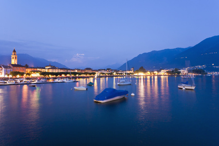 Switzerland,Ticino,View Of Ascona At Dusk With Boats In Lake Maggiore LANG_EVOIMAGES
