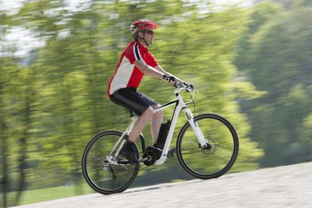 Germany,Bavaria,Munich,Mature Man Riding Electric Bicycle