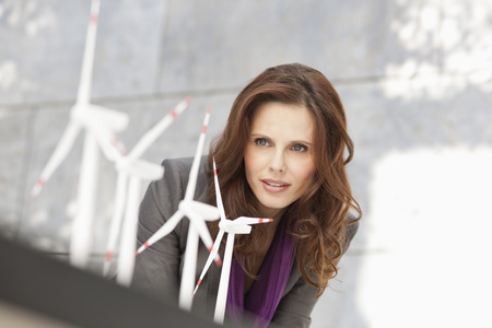 Germany,Leipzig,Businesswoman Looking At Wind Power Model