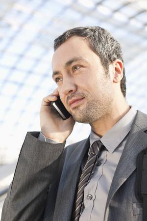 Germany,Leipzig,Businessman Using Cell Phone