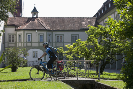 Germany,Bavaria,Man Cycling By Abbey Scheyern LANG_EVOIMAGES