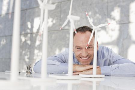 Germany,Leipzig,Businessman With Wind Power Model