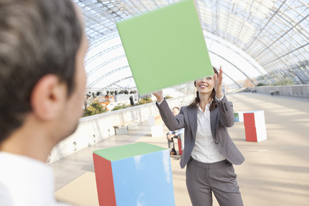 Germany,Leipzig,Business People Playing With Cubes