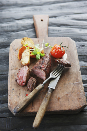 Germany,Bremen,Steak With Vegetable On Chopping Board