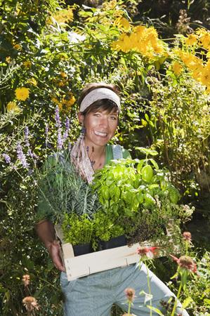 Austria,Salzburg,Flachau,Young Woman In Garden,Smiling,Portrait LANG_EVOIMAGES