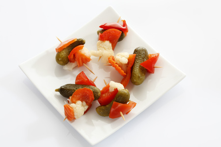 Preserved Mixed Pickles In Plate On White Background