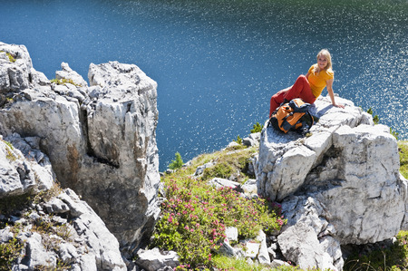 Austria,Salzburg,Hiker Sitting On Rock