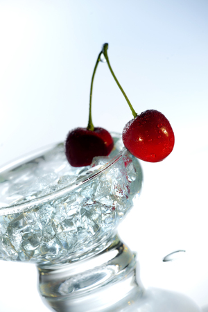 Fresh Cherry With Ice In Bowl On White Background
