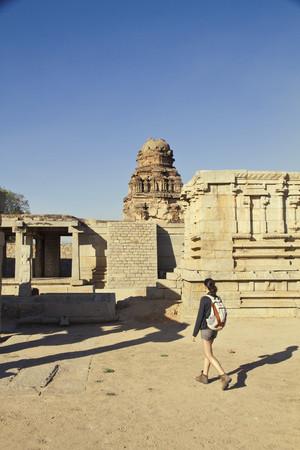 India,Karnataka,Hampi,Young Woman Walking Towards Temple