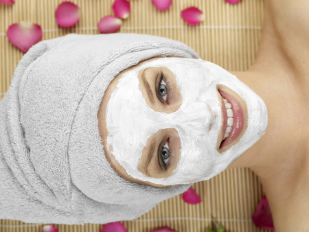 Young Woman With Face Mask At Spa,Smiling,Portrait