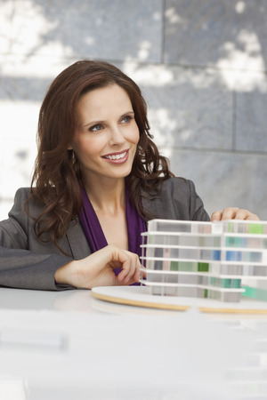 Germany,Leipzig,Businesswoman With Architectural Model LANG_EVOIMAGES