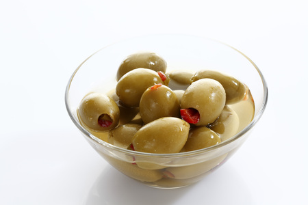 Preserved Filled Green Olive In Glass Bowl On White Background