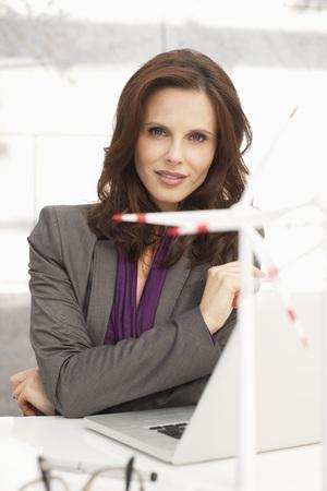 Germany,Leipzig,Businesswoman With Wind Power Model