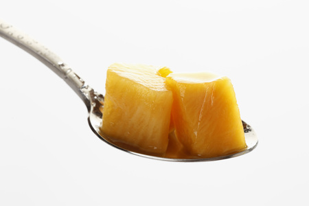 Pickled Pumpkin On Spoon Against White Background LANG_EVOIMAGES
