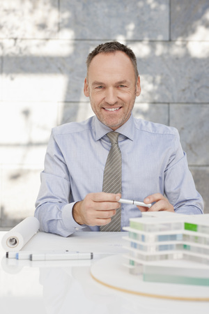 Germany,Leipzig,Businessman With Architectural Model