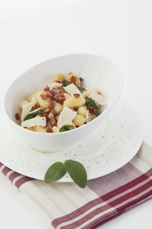 Gnocchi And Bacon With Napkin On White Background LANG_EVOIMAGES