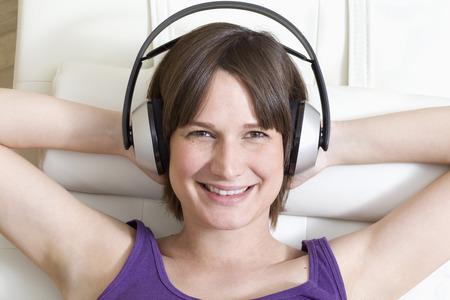 Germany,North Rhine Westphalia,Mid Adult Woman With Headphones,Portrait