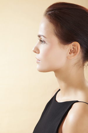 Young Woman In Black Dress,Close Up LANG_EVOIMAGES