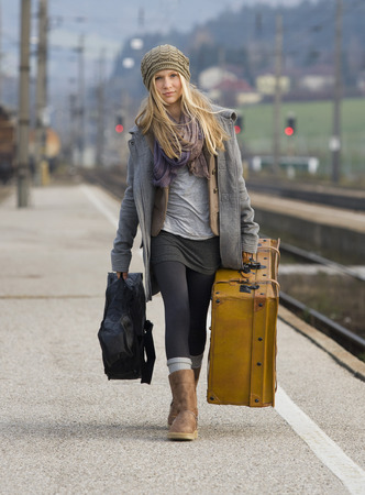 Austria,Teenage Girl With Suitcase On Train Station