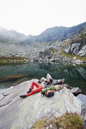 Austria,Styria,Man And Woman Having Rest At Lake Obersee LANG_EVOIMAGES