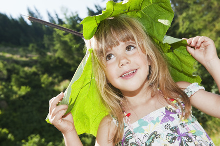 Austria,Salzburg,Girl Carrying Leaf On Head,Smiling
