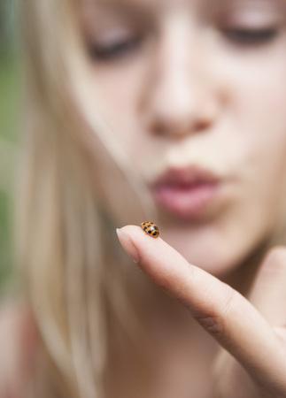 Austria,Teenage Girl Looking At Ladybird On Her Finger