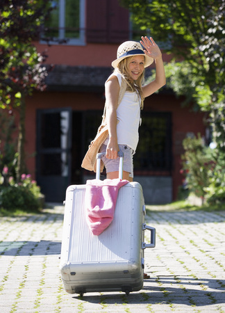 Austria,Teenage Girl Standing With Wheeled Luggage,Portrait