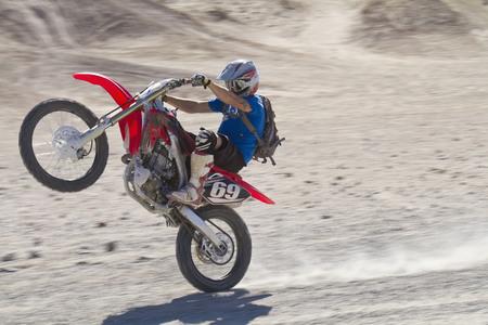 Usa,California,Motocrosser Performing Wheelie On Palm Desert
