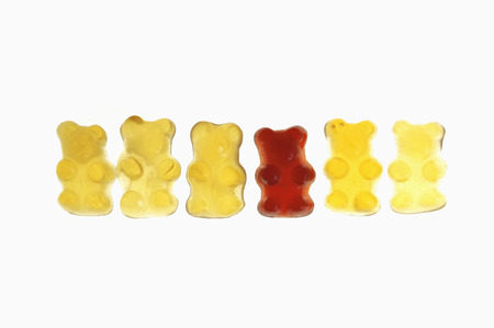 Row Of Gummi Bears On White Background,Close Up