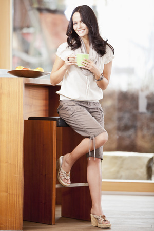 Germany,Bavaria,Young Woman With Cup,Smiling,Portrait LANG_EVOIMAGES