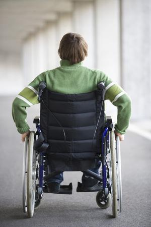 Austria,Mondsee,Young Man Sitting On Wheelchair At Subway
