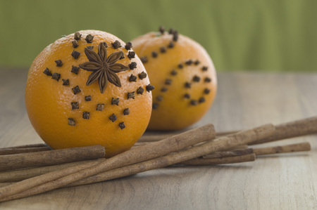 Orange Studded With Cloves And Star Anise,Cinnamon Stick On Table