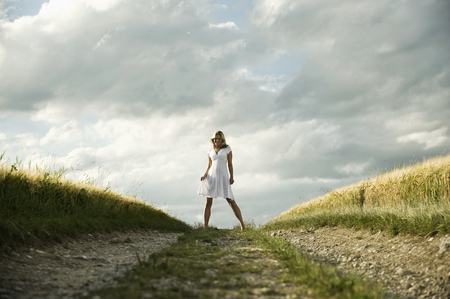 Germany,Bavaria,Mature Woman Standing In Grain Field