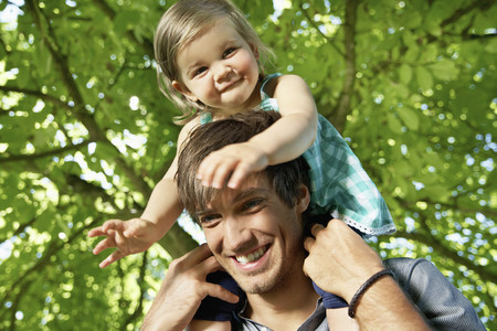 Germany,Cologne,Father Carrying Daughter On Shoulders,Smiling