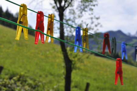 Austria,Empty Clothes Pegs Hanging On Wasing Line LANG_EVOIMAGES