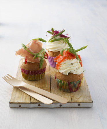 Variety Of Hearty Cup Cakes On Wood Board