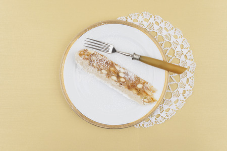 Slice Of Panforte With Fork On Porcelain Plate