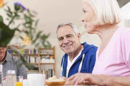Germany,Leipzig,Senior Men And Women Having Breakfast LANG_EVOIMAGES