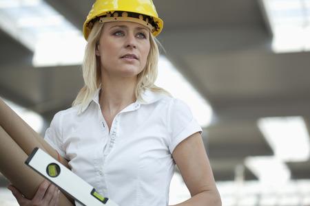 Germany,North-Rhine-Westphalica,Duesseldorf,Female Architect Standing With Blueprint
