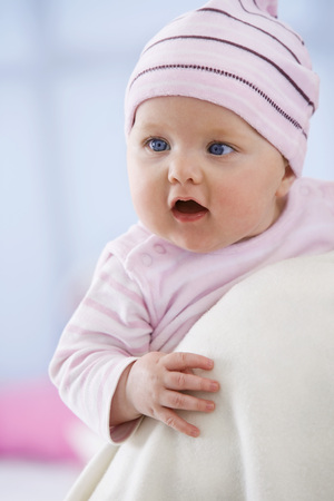 Baby Girl In Woolly Hat With Mouth Open,Close Up LANG_EVOIMAGES