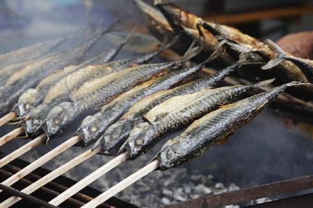 Germany,Bavaria,Close Up Of Grilled Fish On Sticks At Lake Starnberg