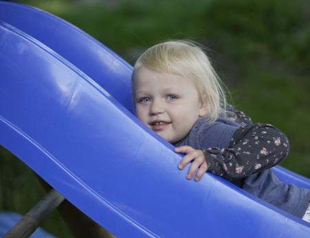 Germany,Bavaria,Girl Playing On Slide LANG_EVOIMAGES