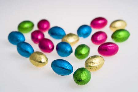 Colourful Foil Wrapped Chocolates On White Background