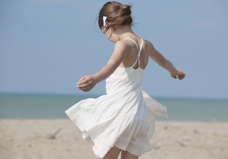 Spain,Girl Playing On Beach