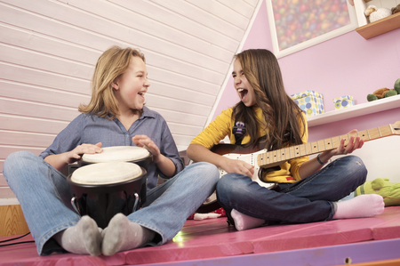 Girls Playing Guitar And Drums,Laughing