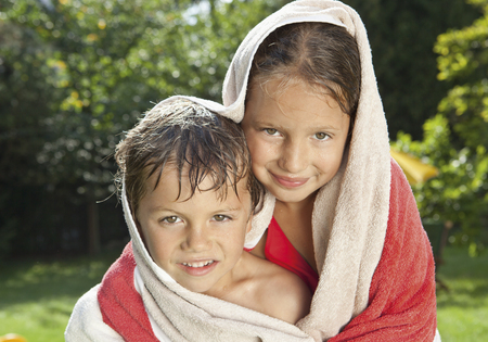 Germany,Boy And Girl Wrapped In Bath Towel,Smiling,Portrait