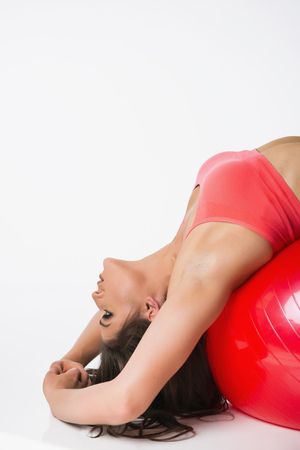 Young Woman Exercising With Medicine Ball On White Background