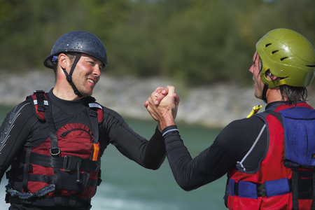 Germany,Canoeists Shaking Hands,Close Up