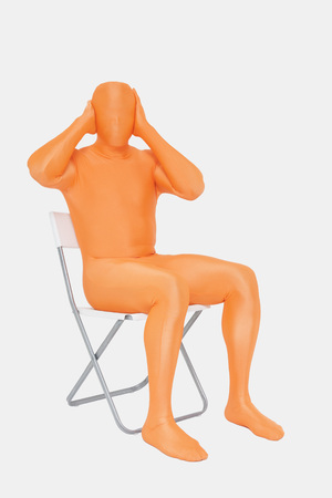Mature Man In Orange Zentai With Hands Covering Ears